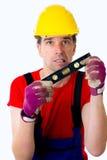 Śmieszny pracownik z poziomem wody Zdjęcia Royalty Free