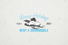 Mieten Sie ein Schneemobil fahrung für Winterurlaube und Ferien Stockfotografie