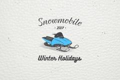 Mieten Sie ein Schneemobil fahrung für Winterurlaube und Ferien Stockbild
