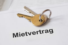 Mietvertrag German lease agreement. Document with set of house keys Royalty Free Stock Image