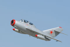 MiG-15. A Mikoyan-Gurevich MiG-15 two-seater jet fighter with Soviet markings. The MiG-15 was developed for the USSR  by Artem Mikoyan and Mikhail Gurevich. It Royalty Free Stock Photos