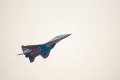 MiG-29 (Strizhi) demonstrates aerobatics. KUBINKA, RUSSIA - AUGUST 14: MiG-29 #09 from Strizhi squad demonstrates aerobatics during the celebration of 100th Royalty Free Stock Photos