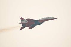 MiG-29 (Strizhi) demonstrates aerobatics. KUBINKA, RUSSIA - AUGUST 14: MiG-29 #09 from Strizhi squad demonstrates aerobatics during the celebration of 100th Stock Photography