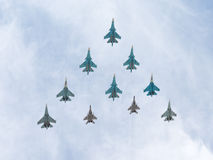 MiG-29 and Sukhoi flying pyramid Royalty Free Stock Photography