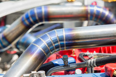 Mig welded seam on stainless steel pipe in racing car. Mig welded seam on stainless steel turbocharger pipe in racing car royalty free stock photos