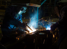 MIG welder uses torch to make sparks during manufacture. Of metal equipment Royalty Free Stock Photography