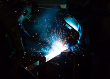 MIG welder uses torch to make sparks during manufacture. Of metal equipment Stock Image