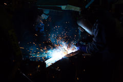 MIG welder uses torch to make sparks during manufacture. Of metal equipment Royalty Free Stock Image