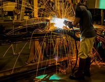 MIG welder uses torch to make sparks Royalty Free Stock Photo