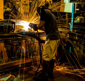 MIG welder uses torch to make sparks Stock Image