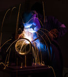 MIG welding steel pipe stock photos