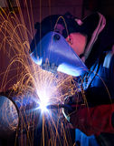 MIG welding on steel tube Royalty Free Stock Photos