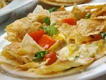 Tex-Mex Migas. Migas, Tex-Mex cuisine, diced onions, sliced chile peppers, diced fresh tomatoes, or cheese,, Traditional assorted dishes, Top view stock image