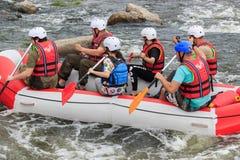Migea Ukraine - June 17, 2017. Group of adventurer enjoying water rafting activity at river Migea Ukraine on June 17 Royalty Free Stock Photo