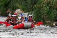 Migea Ukraine - June 17, 2017. Group of adventurer enjoying water rafting activity at river Migea Ukraine on June 17 Stock Images