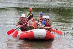 Migea Ukraine - June 17, 2017. Group of adventurer enjoying water rafting activity at river Migea Ukraine on June 17 Royalty Free Stock Images