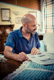Miggle age man reading newspaper Royalty Free Stock Image