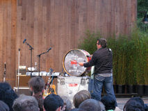 They Might Be Giants member John Flansburgh bang drums Royalty Free Stock Images