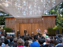 They Might Be Giants singing into mics on stage. SAN FRANCISCO - AUGUST 22: 73rd Stern Grove Festival: They Might Be Giants singing into mics on stage at am Royalty Free Stock Photo