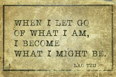 Might be LT. When I let go of what I am - ancient Chinese philosopher Lao Tzu quote printed on grunge vintage cardboard Royalty Free Stock Photo