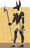 Mighty Great dark Anubis on Egypt background.  Royalty Free Stock Images