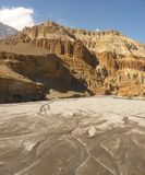 The mighty Kali Gandaki river bed in Nepal. The Kali Gandaki river bed surrounded by beautiful mountains in Mustang, Nepal Royalty Free Stock Images