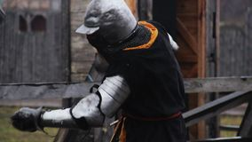 Mighty knight attacking rival with sword during tournament, medieval competition. Stock footage stock video footage