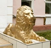 Mighty, majestic, formidable sculpture of a lion. On a white background royalty free stock photos