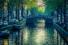 The mighty opulent canals of Amsterdam stock images