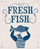 Mighty sailor fisherman. The mighty cartoon sailor with fish on old wall background. Poster for fresh fish Stock Photo