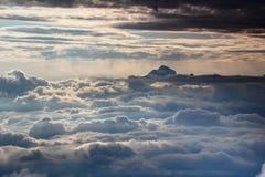 Triglav peak above sunlit sea of clouds, Julian Alps, Slovenia royalty free stock photography