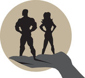 Mighty support. Man and woman supported by a hand Stock Images