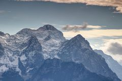 Mighty Triglav the highest peak of Slovenia covered with snow Stock Photo