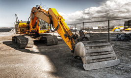Mighty yellow excavator stock image