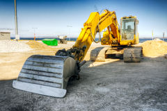 Mighty yellow excavator Royalty Free Stock Photo
