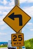 25 MIGLIA ORARIE di ArrowSign di svolta a sinistra Fotografia Stock