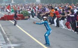 Migliaia di gente che fa insieme ginnastica Fotografia Stock