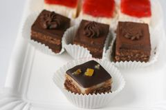 Mignon small sweet cakes Stock Photography