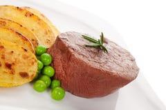 Mignon steak with fresh vegetable. Royalty Free Stock Photos