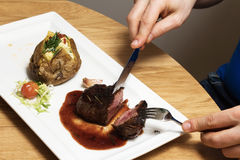 Mignon steak. Juicy Filet Mignon on a white plate royalty free stock photography