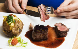 Mignon steak. Juicy Filet Mignon on a white plate stock photo