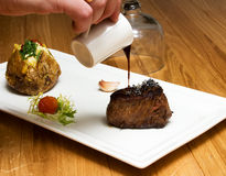 Mignon steak. Juicy Filet Mignon on a white plate stock photography