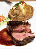 Mignon steak. Juicy Filet Mignon on a white plate royalty free stock photo