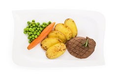 Mignon steak on plate, top view. Stock Photo