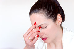 Migraine as an integral part of life. A young woman has a strong headache,photography Royalty Free Stock Photos