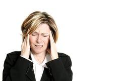 Migraine de femme d'affaires images stock