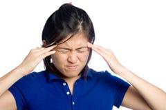 Migraine gil. Asian girl has a headache Royalty Free Stock Photography