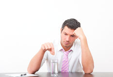 Migraine office man with pill Stock Image