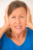 Migraine stressed woman covering ears Stock Photos