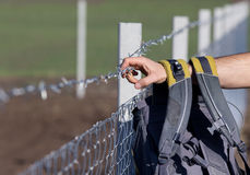 Migrant with backpack on the border Stock Photography